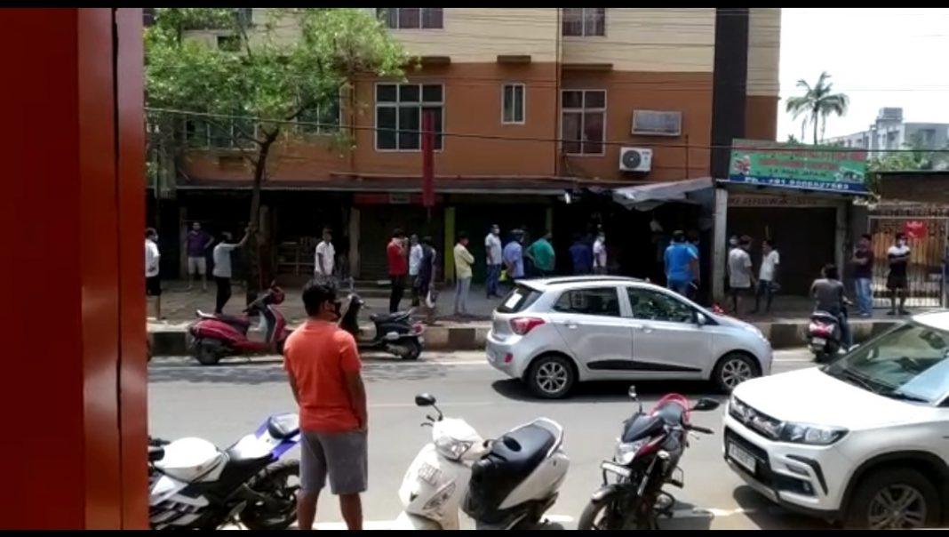 Long queue in front of liquor shops in Assam
