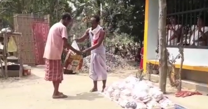 Assam man distributes food items