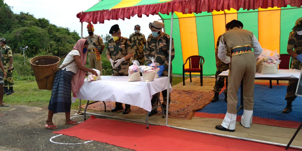 BSF soldiers providing essentials to people.