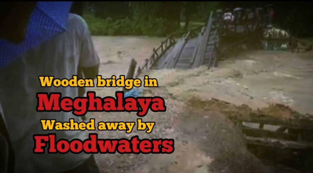 A wooden bridge in Meghalaya's South Garo Hills washed away by floodwaters