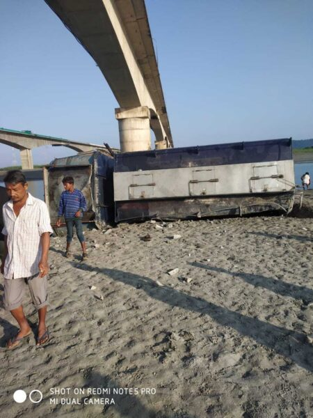 One killed after an oil tanker broke bridge railings and fell into Brahmaputra river