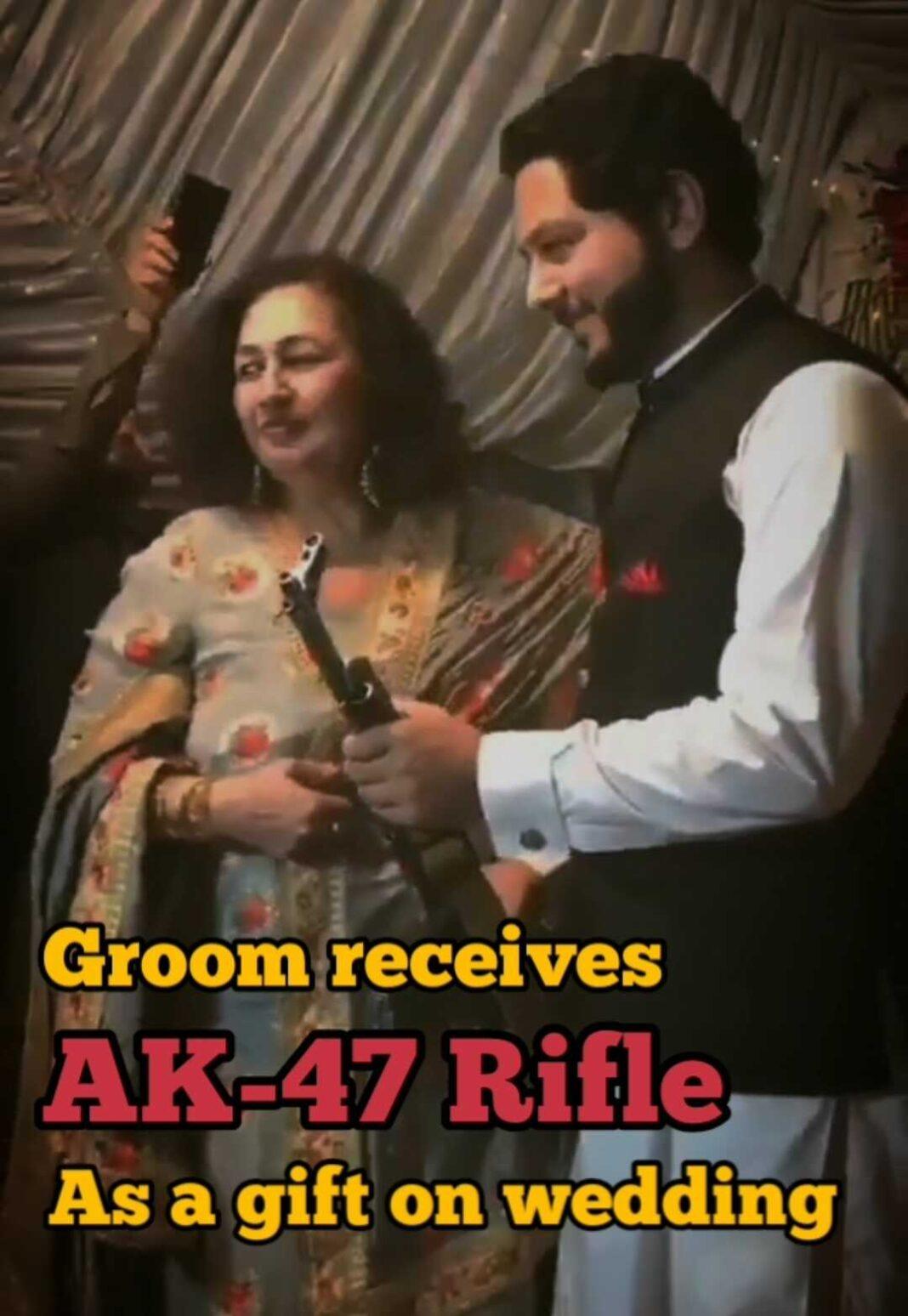 Groom receives AK-47 on wedding day